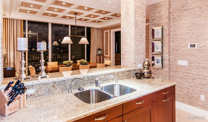 Kitchen and Dining Room in Residence 406 at Bellaria, Luxury Oceanfront Condominiums in Palm Beach, Florida 33480.