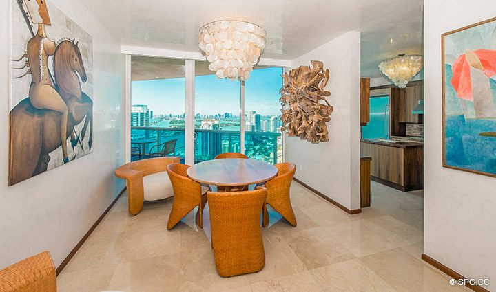 Dining Room with City Views in Residence 3806 at Portofino Tower, Luxury Waterfront Condominiums in Miami Beach, Florida 33139