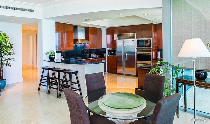 Dining Room and Kitchen inside Residence 902 For Rent at One Bal Harbour, Luxury Oceanfront Condos in Bal Harbour, Miami, Florida 33154.
